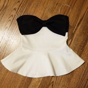 Body central white top with black bow